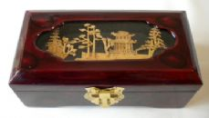 Small Oblong Jewellery Box with cork carving on lid.